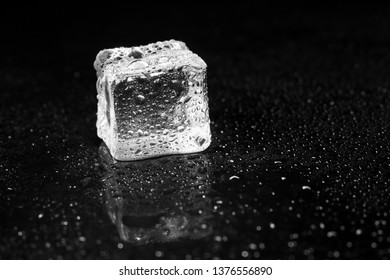 ice cubes on black table background.