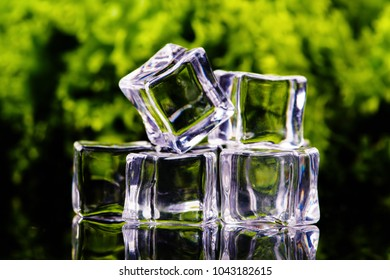 ice cubes on a green background