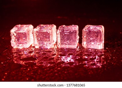 ice cubes on a reflections red light.