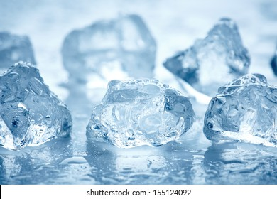 ice cubes on a wet light blue background