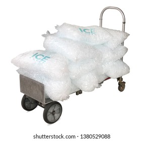 Ice cubes in plastic bags on delivery cart, bagged ice or packaged ice isolated on white background including clipping path.