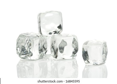 Ice cubes in a pool of water isolated on a white background