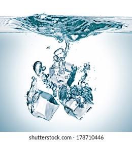 ice cubes splash in water