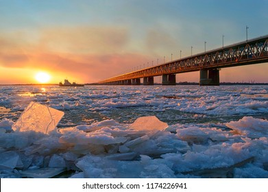 Ice drift on the Amur river.  Amur bridge, Trans siberian railway. Khabarovsk, far East, Russia.
