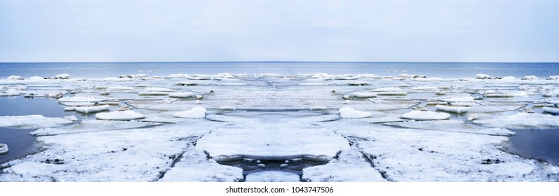 Ice drift on Baltic sea. Spring cloudy day. Abstract landscape photo.