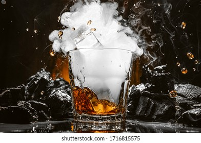 ice falls into a glass with a carbon dioxide cocktail and smoke forms