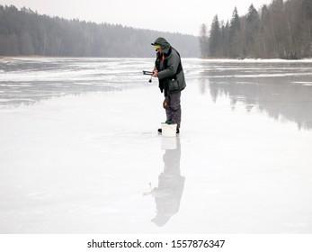 ice fishermen , beautiful glaciers on ice and water, winter