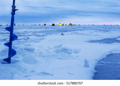 Ice fishing background with ice drill