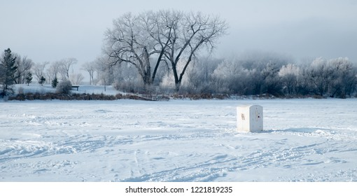 Ice Fishing House on Frozen Lake in Winter