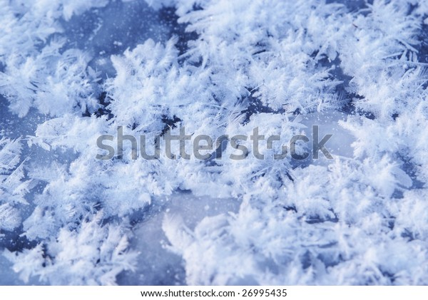 Ice flakes on blue frozen background