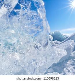 Ice floe and sun on winter Baikal lake