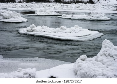 Ice floes drifing downstream in a river Mures, close to the city of Targu Mures in Transylvania, Romenia.