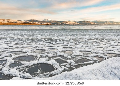 Ice floes gathering at shore of Lake Laberge, Yukon Territory, Canada, before winter freeze up
