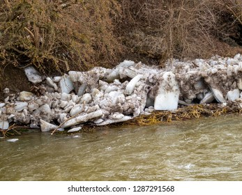 Ice floes on the riverbank of the swollen February Vidima River in the Fore-Balkan village of Debnevo, Central-North Bulgaria after an ice jam