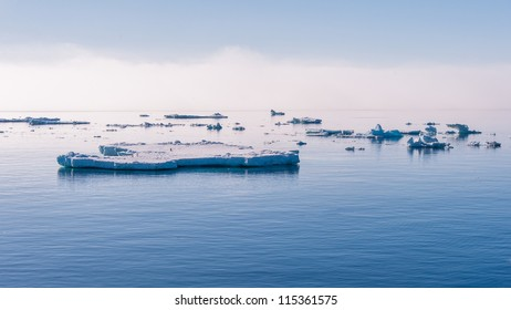 Ice floes, sunset in Antarctica