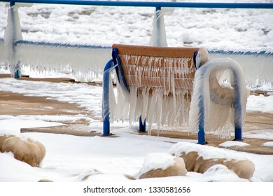 ice formation with icicles on park bench