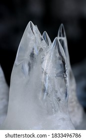 Ice forms pillars beneath an upheaved sheet of ice at Copper Fal