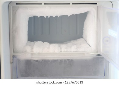 Ice full in empty freezer of a refrigerator makes refrigerator work harder and  broken.