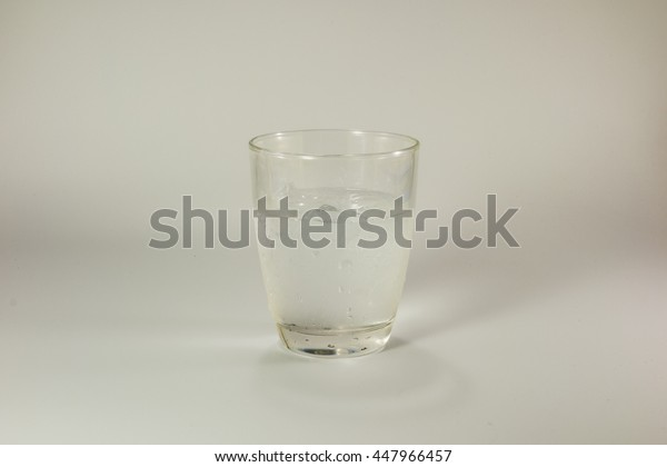 the ice in the glass of water