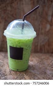 Ice green tea cold on wood table