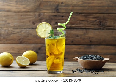 ice green tea in glass on rustic background