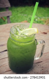 Ice green tea with lemon on a jar