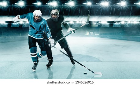 Ice Hockey Arena. Two players competition in the helmet and gloves on stadium with stick and puck.