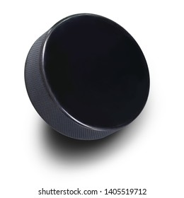 A Ice hockey Black rubber hockey puck  in upright position with copy space isolated on white background for sports design. This has clipping path.