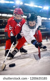 Ice hockey boys player in sport action on the ice