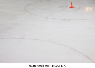 ice hockey floor with orange trafic cone for training, empty ice rink sport stadium with red line marking