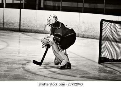 Ice hockey game action shot of the goalie