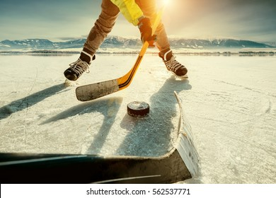 Ice hockey on the frozen lake game moment