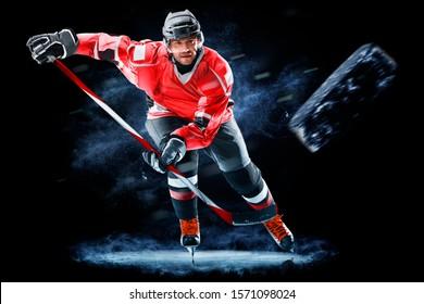 Eishockeyspieler einzeln auf schwarzem Hintergrund