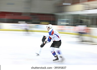 Ice hockey player in motion on the ice