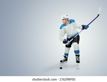 Ice hockey player ready to shoots the puck