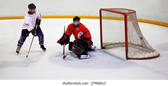 Ice hockey player shoots and scores