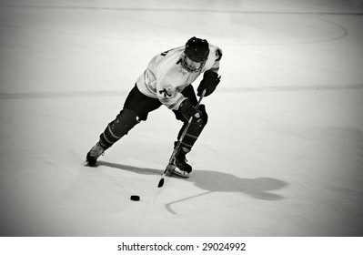 Ice hockey player skates with the puck