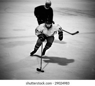 Ice hockey player skating with the puck