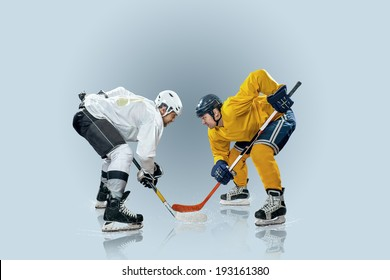 Ice hockey players on the ice and light effects