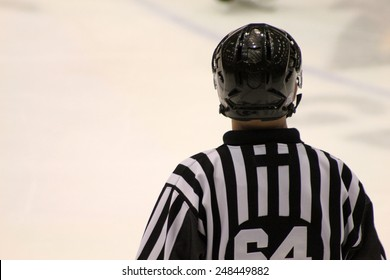 Ice Hockey Referee Watches Game