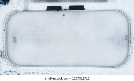 Ice Hockey Rink. Boy playing ice hockey alone.