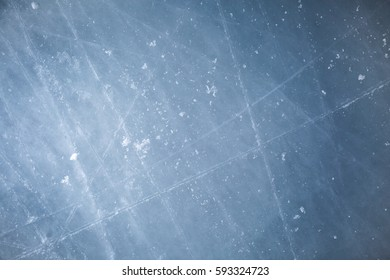 Ice hockey rink scratches surface for texture or background, winter closeup top view image copy space.