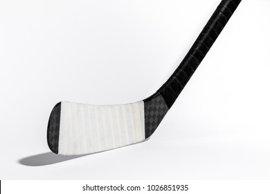 Ice hockey stick on isolated white background, equipment for hockey player in winter game season, closeup on Wooden head ice hockey stick Kevlar design.