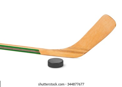 Ice hockey stick and puck isolated on white background