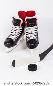Ice hockey stick and shoe and puck on rink scratches surface for texture or background, winter closeup top view image