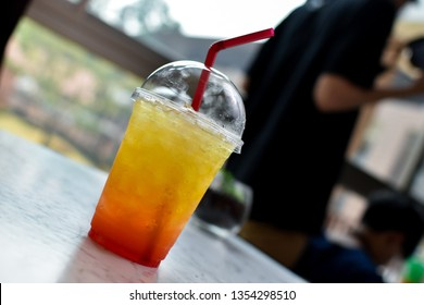 Ice Italian soda in plastic cup, beverage for summer