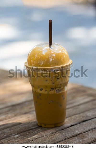 ice milk tea sweet on wooden table