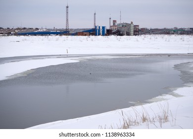 Ice at the North pole and near degrees . Now the long-term ice is broken by the nuclear icebreaker. Broken ice across the canal . Dark water sky indicates open water