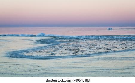 Ice on the beach in sunset