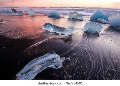 Ice on the black volcanic beach near Jokulsarlon glacier lagoon, winter Iceland